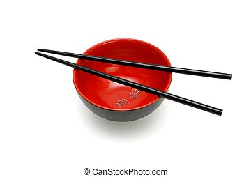 Chopsticks on red and black Japanese bowl isolated -...