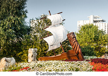 Wooden ship in Park at summer day