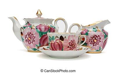 Beautiful porcelain tea service isolated - Old-fashioned tea...