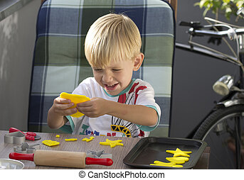 Boy playing with plasticine - Young boy playing with...