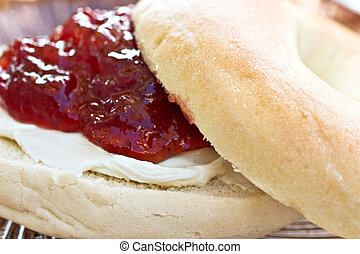Bagel with cream cheese and strawberry preserves