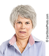 Angry expression - Portrait of a elderly woman with a angry...