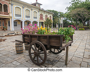 Vintage wheel barrel full of flowers at a National Park in...