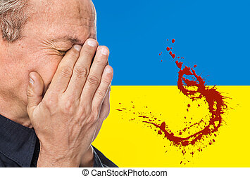 The war in Ukraine. Elderly man covered his face against the...