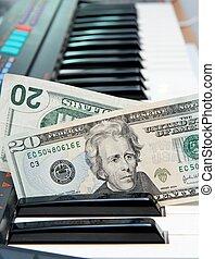 Twenty dollar bills in electric organ keyboard