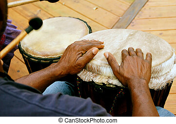 drum circle mans hands - Looking over a mans shoulders as he...