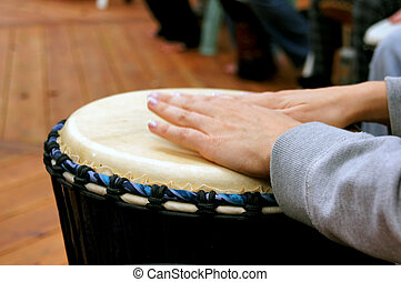 drum circle woman hands - Close up of woman's hands as she...