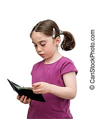 Serious seven years girl with pigtails holds a wallet with...