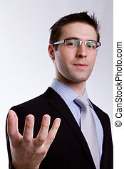 Portrait of young business man presenting and showing with...
