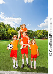 Happy kids with won cup stand in pyramid shape together
