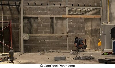 Asian Worker Welding at Construction Area Construction of a...