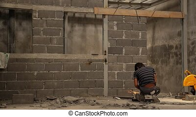 Worker Welding and Building Concrete Wall Migrant Worker at...