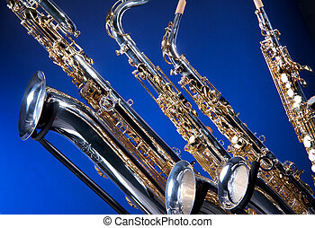 Four Saxophones on Blue - A set of four saxophones including...