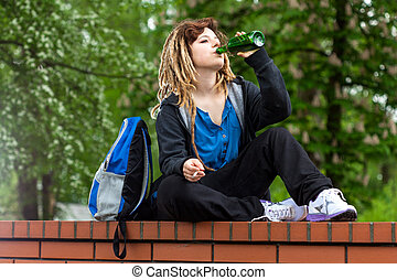 Girl playing hookey and drinking alcohol - Rude girl playing...