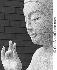 Buddha statue - Monochrome image of a granite statue of...