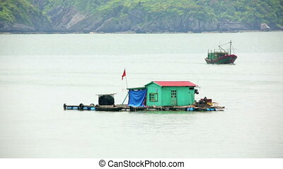 floating village at limestone islands, Halong Bay, Vietnam