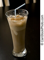Root Beer Float with Straw in a Glass.