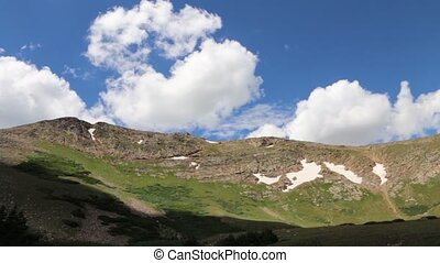 Clouds Moving Over A Mountain Ridge - Clouds move over a...