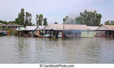 floating market slums near factory, mekong delta, vietnam