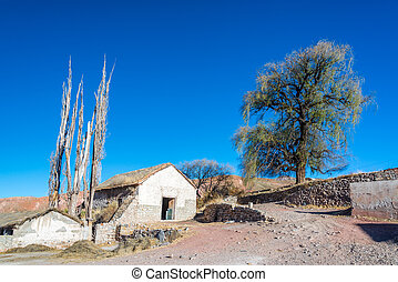 Rural Bolivia View - Old stone building in arid rural...