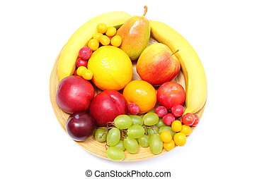 Fresh ripe fruits on wooden plate - Fresh ripe fruits lying...