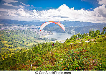 Paragliders take off from Sarangkot, Pokhara valley. Nepal....