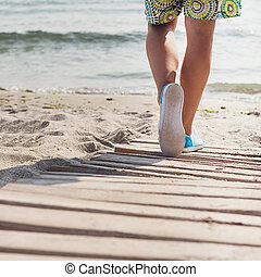 Woman walks at the beach - Beautiful woman walks at the sea...