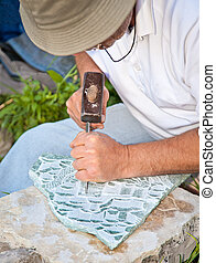 Traditional stone carving in Gjirokaster, Albania. -...