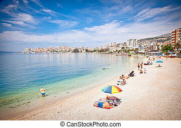 Tourists on pablic beach in Saranda, Albania. - SARANDA,...