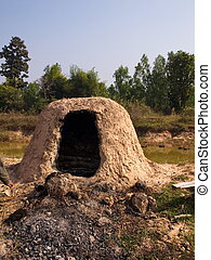 Charcoal mound - Dome shaped charcoal mound traditionally...