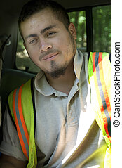Construction worker - A construction worker pauses briefly...