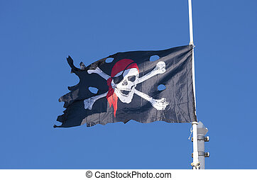 pirate flag against a blue sky