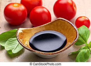 Balsamic vinegar - Bowl of Balsamic vinegar and basil leaves