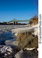 St. Lawrence river - Frozen ice floating down the St....