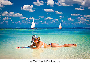 Woman relax on the tropical beach in Africa - Young fashion...