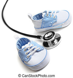 Pediatrics - Baby shoes with stethascop against a white...