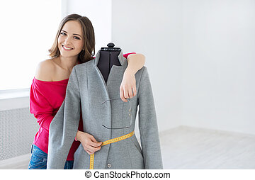 Creative girl - Young fashion designer in the studio