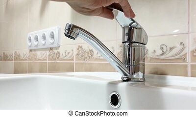 Bathroom faucet - Woman washing her hands in bathroom sink