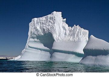 large iceberg sunny summer day off the coast of Antarctica