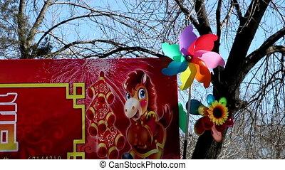 Colorful pinwheels rotate in wind - Colorful pinwheels...