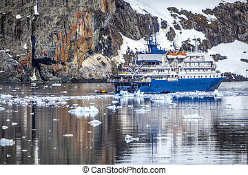 Ship anchored in a bay on the Antarctic Peninsula Photo;...