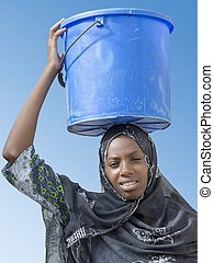 Afro beauty carrying water - Afro beauty carrying a bucket...
