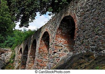 Red brick arches of medieval castle in Schallaburg, Austria