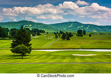 View of a golf course and distant mountains at Canaan Valley...