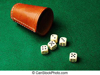 dices  - Five dices and a leather cup on green cloth