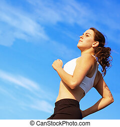 Beautiful Woman Runner - Beautiful young woman runner having...