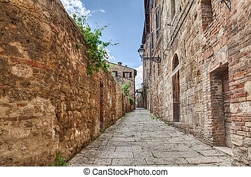 ancient alley in Colle di Val d'Elsa, Tuscany, Italy -...