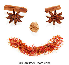 Smile face made from spices isolated on white