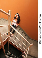 Melancholic Stairway - A young woman listening to...