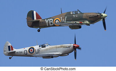 Spitfire and Hurricane flying side by side during a public...